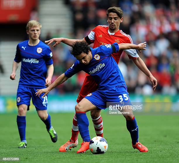 Fabio of Cardiff holds off the challenge from Gaston Ramirez of Southampton during the Barclays Premier League match between Southampton and Cardiff...