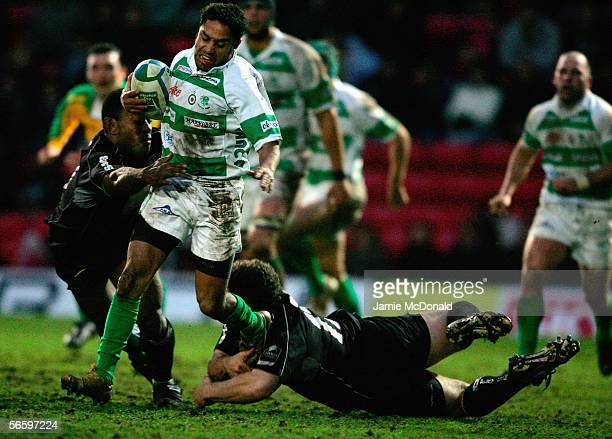 Fabio Ongaro of Treviso is tackled by Ben Johnson of Saracens during the Heineken Cup Pool 4 match between Saracens and Benetto Treviso at Vicarage...