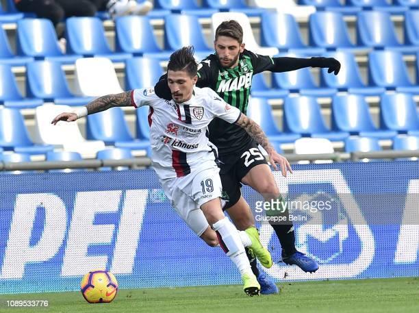 Fabio Pisacane of Cagliari and Domenico Berardi of US Sassuolo in action during the Serie A match between US Sassuolo and Cagliari at Mapei Stadium...