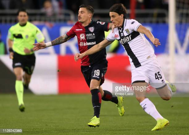 Fabio Pisacane of Cagliari and Roberto Inglese in contrast during the Serie A match between Cagliari and Parma Calcio at Sardegna Arena on February...