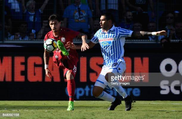 Fabio Pisacane of Cagliari Calcio competes for the ball whit Marco Boriello of Spal during the Serie A match between Spal and Cagliari Calcio at...