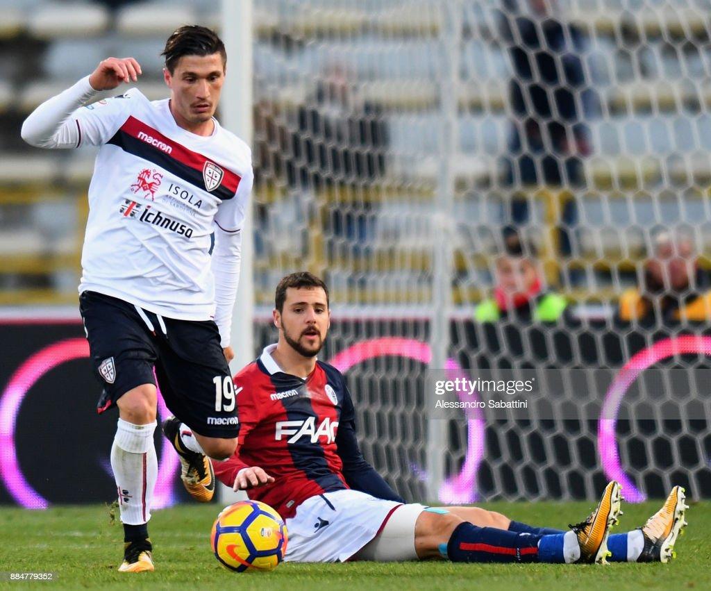 Fabio Pisacane of Cagliari Calcio competes for the ball whit Mattia Destro of Bologna FC during the Serie A match between Bologna FC and Cagliari Calcio at Stadio Renato Dall'Ara on December 3, 2017 in Bologna, Italy.