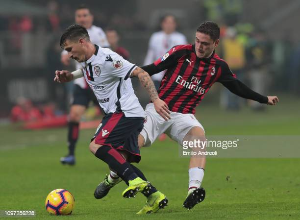 Fabio Pisacane of Cagliari Calcio is challenged by Davide Calabria of AC Milan during the Serie A match between AC Milan and Cagliari at Stadio...