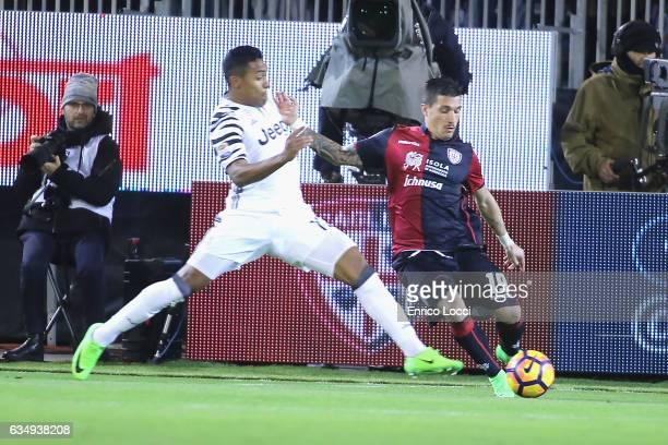 Fabio Pisacane of Cagliari in contrast with Juan Cuadrado during the Serie A match between Cagliari Calcio and Juventus FC at Stadio Sant'Elia on...