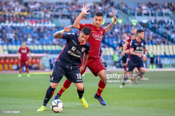 Fabio Pisacane of Cagliari is challenged by Lorenzo Pellegrini of AS Roma during the Serie A match between AS Roma and Cagliari at Stadio Olimpico on...