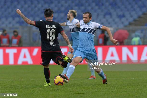 Fabio Pisacane Senad Lulic during the Italian Serie A football match between SS Lazio and Cagliari at the Olympic Stadium in Rome on december 22 2018