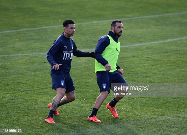 Fabio Quagliarella and Armando Izzo of Italy in action during a training session at Centro Tecnico Federale di Coverciano on March 19 2019 in...