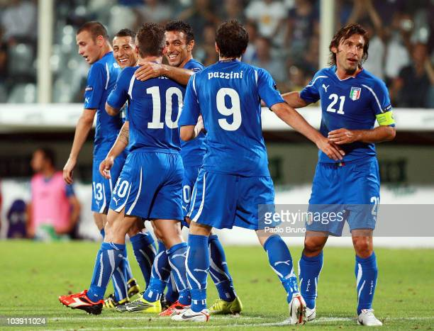 Fabio Quagliarella of Italy celebrates with his teammates after scoring the fourth goal during the Euro 2012 Group C qualifier match between Italy...