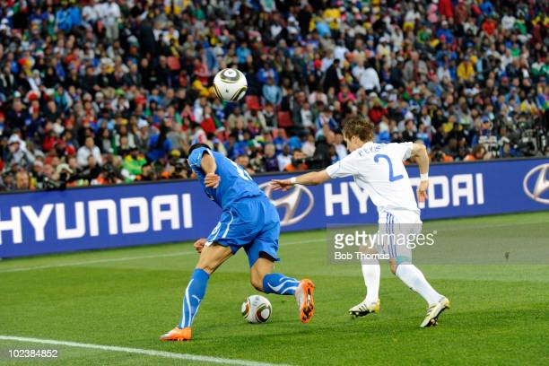 Fabio Quagliarella of Italy chased by Peter Pekarik of Slovakia as the crowd throw in an extra ball during the 2010 FIFA World Cup South Africa Group...