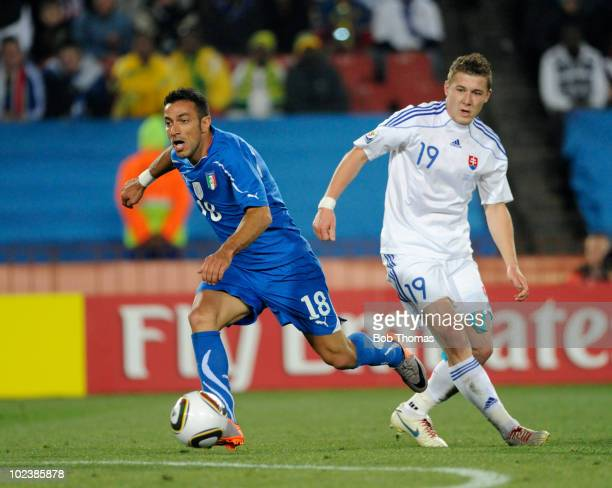 Fabio Quagliarella of Italy with Juraj Kucka of Slovakia during the 2010 FIFA World Cup South Africa Group F match between Slovakia and Italy at...