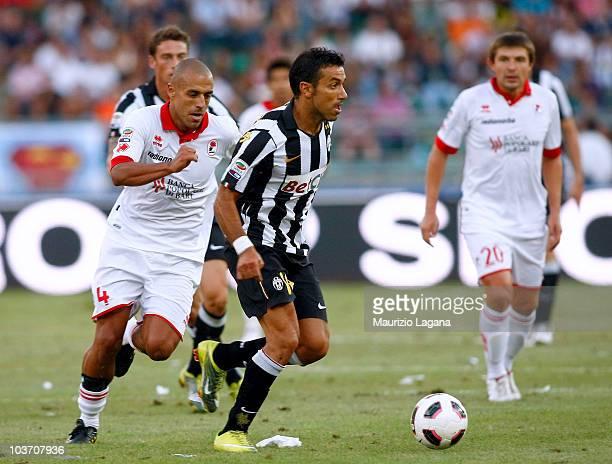 Fabio Quagliarella of Juventus FC battles for the ball with Sergi Almiron of AS Bari during the Serie A match between Bari and Juventus at Stadio San...