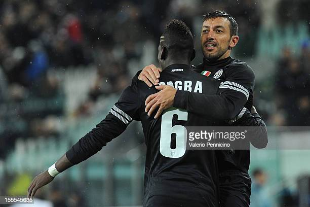 Fabio Quagliarella of Juventus FC celebrates with his teammates Paul Pogba after scoring the opening goal during the Serie A match between Juventus...
