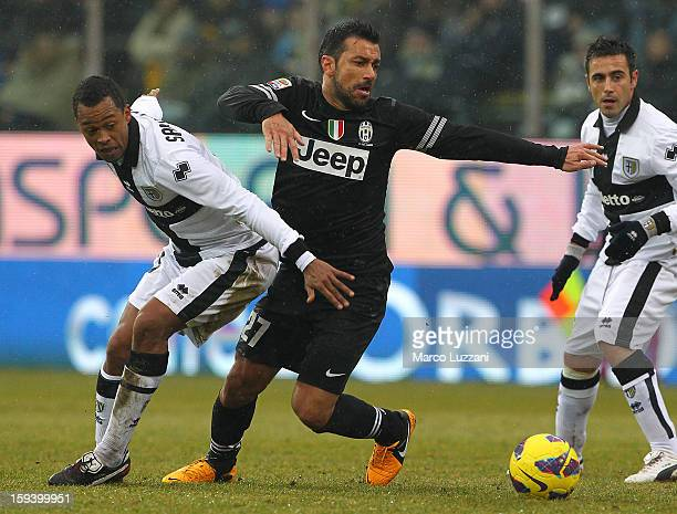 Fabio Quagliarella of Juventus FC competes for the ball with Fabiano Santacroce of FC Parma during the Serie A match between Parma FC and Juventus FC...