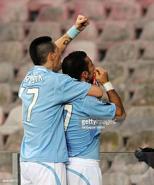 Fabio Quagliarella of Napoli celebrates his 20 goal in front of fans joined by teammate Marek Hamsik during the Serie A match between Napoli and...