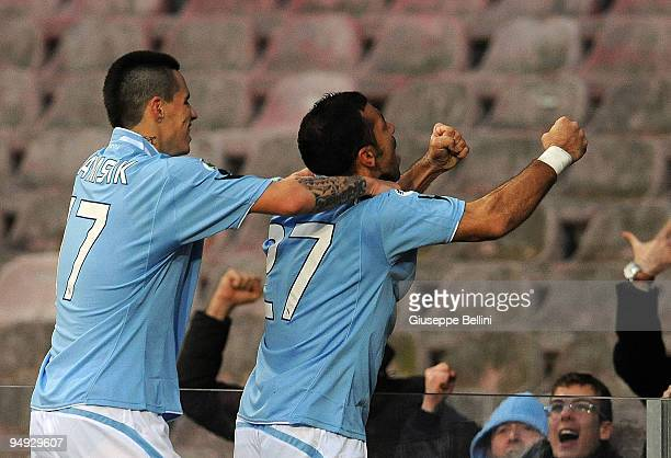 Fabio Quagliarella of Napoli celebrates his 20 goal with fans joined by teammate Marek Hamsik during the Serie A match between Napoli and Chievo at...