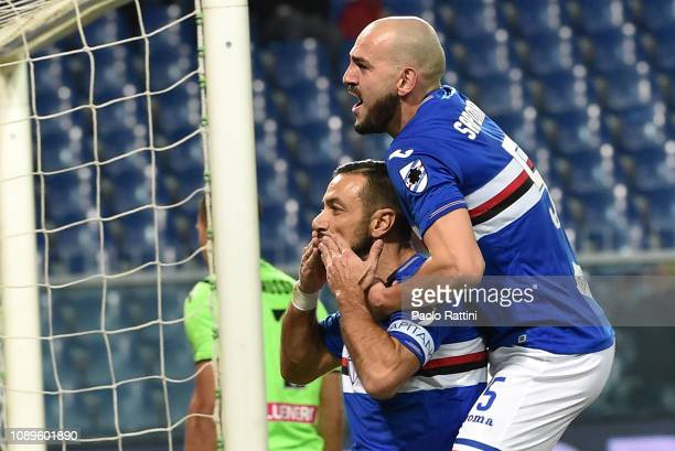 Fabio Quagliarella of Sampdoria celebrates with Riccardo Saponara after penalty for 10 during the Serie A match between UC Sampdoria and Udinese at...
