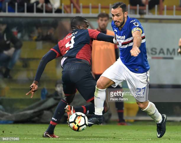 Fabio Quagliarella of Sampdoria competes with Isaac Cofie of Genoa during the serie A match between UC Sampdoria and Genoa CFC at Stadio Luigi...