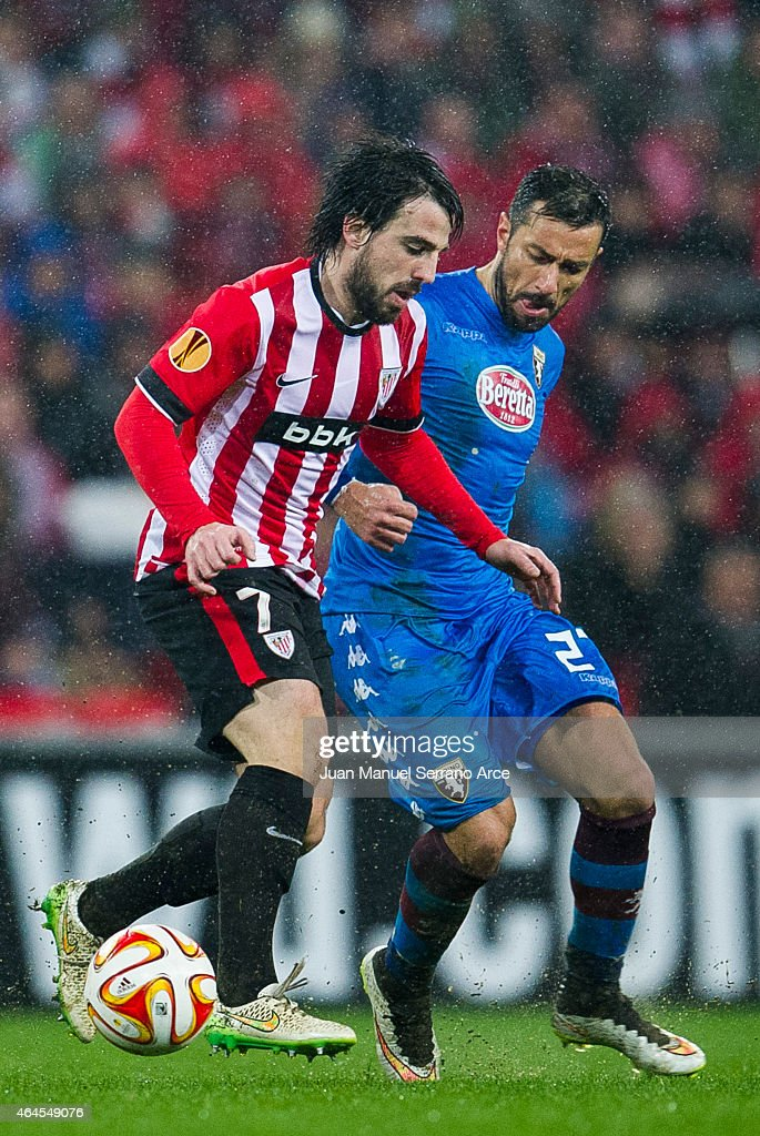 Fabio Quagliarella of Torino FC duels for the ball with Benat Etxebarria of Athletic Club during the UEFA Europa League Round of 32 match between Athletic Club and Torino FC on at San Mames Stadium on February 26, 2015 in Bilbao, Spain.