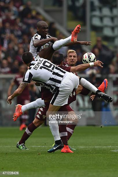 Fabio Quagliarella of Torino FC is challenged by Angelo Ogbonna and Leonardo Bonucci of Juventus FC during the Serie A match between Torino FC and...