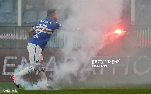Fabio Quagliarella of UC Sampdoria clears a flare from the pitch during the Serie A match between UC Sampdoria and ACF Fiorentina at Stadio Luigi...