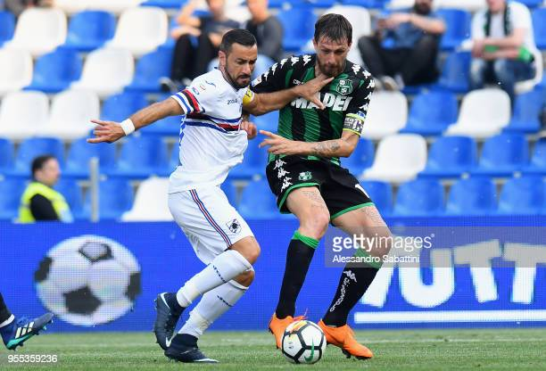 Fabio Quagliarella of UC Sampdoria competes for the ball whit Francesco Acerbi of US Sassuolo during the serie A match between US Sassuolo and UC...