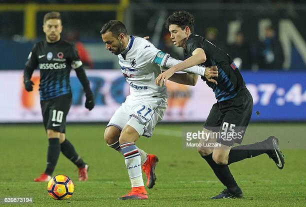 Fabio Quagliarella of UC Sampdoria competes for the ball with Alessandro Bastoni of Atalanta BC during the Serie A match between Atalanta BC and UC...