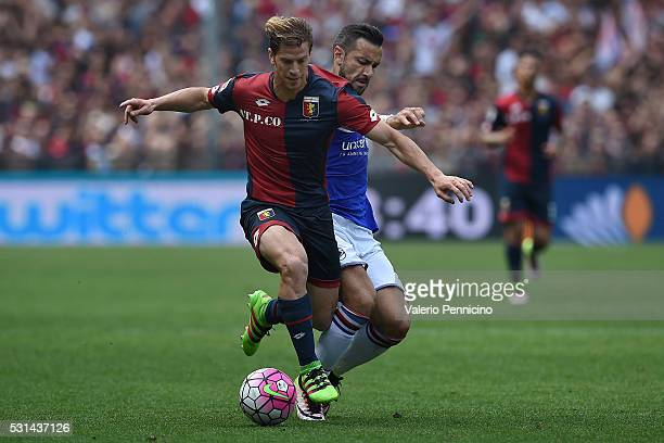 Fabio Quagliarella of UC Sampdoria competes with Cristian Ansaldi of Genoa CFC during the Serie A match between UC Sampdoria and Genoa CFC at Stadio...