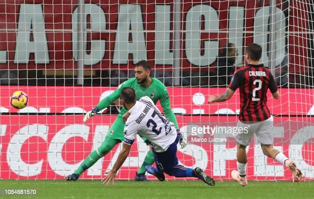 Fabio Quagliarella of UC Sampdoria scores his goal during the Serie A match between AC Milan and UC Sampdoria at Stadio Giuseppe Meazza on October 28...