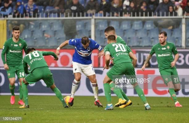 Fabio Quagliarella of UC Sampdoria stopped by ACF Fiorentina defenders during the Serie A match between UC Sampdoria and ACF Fiorentina at Stadio...