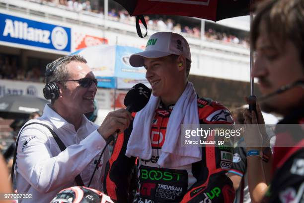 Fabio Quartararo of France and Beta Tools Speed Up Racing speaks with journalist and prepares to start on the grid during the Moto2 race during the...