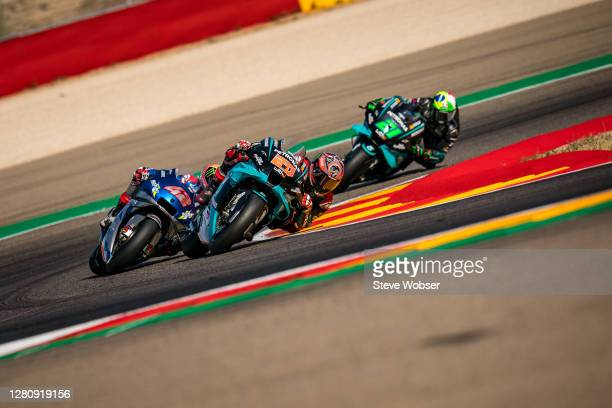 Fabio Quartararo of France and Petronas Yamaha SRT in front of Alex Rins of Spain and Team SUZUKI ECSTAR and Franco Morbidelli of Italy and Petronas...