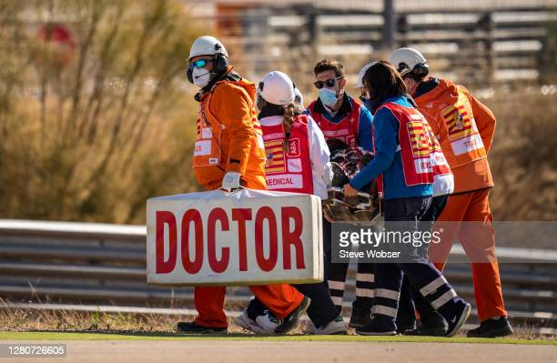 Fabio Quartararo of France and Petronas Yamaha SRT is transported away on a stretcher by medical staff after his crash during the free practice...