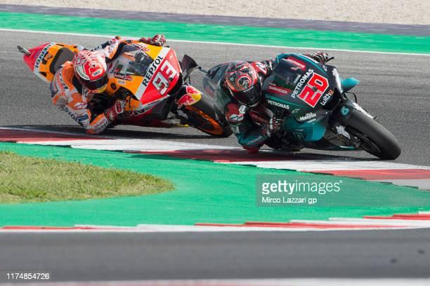 Fabio Quartararo of France and Petronas Yamaha SRT leads Marc Marquez of Spain and Repsol Honda Team during the MotoGP race during the MotoGp of San...