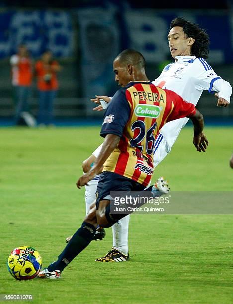 Fabio Rodríguez of Aguilas Doradas struggles for the ball with Rafael Robayo of Millonarios during a match between Aguilas Doradas and Millonarios as...