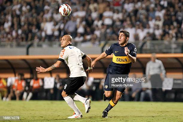 Fabio Santos of Corinthians fights for the ball with Erviti of Boca Juniors during a match between Corinthians and Boca Juniors as part of the Copa...