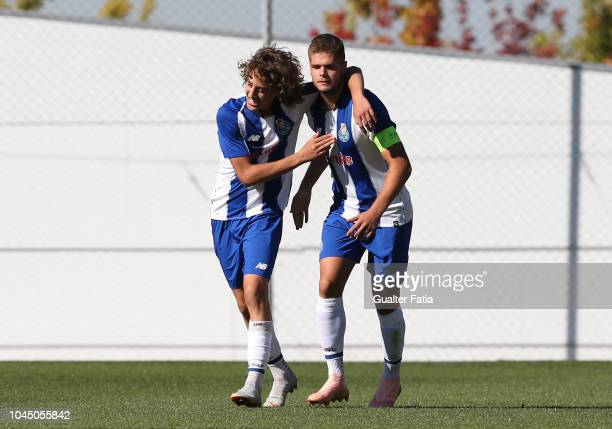 Fabio Silva of FC Porto celebrates with teammate Diogo Queiros of FC Porto after scoring a goal during the UEFA Youth League match between FC Porto...