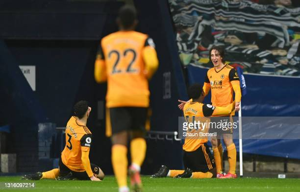 Fabio Silva of Wolverhampton Wanderers celebrates with Owen Otasowie and Rayan Ait-Nouri after scoring their side's first goal during the Premier...