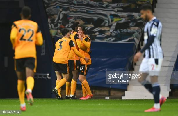 Fabio Silva of Wolverhampton Wanderers celebrates with team mates after scoring their side's first goal during the Premier League match between West...