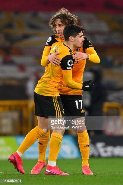 Fabio Silva of Wolverhampton Wanderers celebrates with teammate Pedro Neto after scoring their team's second goal during the Premier League match...
