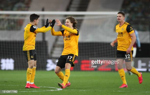 Fabio Silva of Wolverhampton Wanderers celebrates with teammates Pedro Neto and Leander Dendoncker of Wolverhampton Wanderers after scoring their...