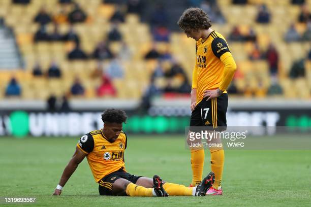Fabio Silva of Wolverhampton Wanderers checks on Adama Traore of Wolverhampton Wanderers after he went down with an injury during the Premier League...
