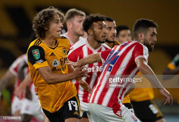 Fabio Silva of Wolverhampton Wanderers emerges from a pack of Stoke City defenders during the Carabao Cup second round match between Wolverhampton...