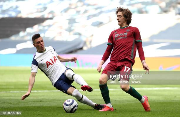 Fabio Silva of Wolverhampton Wanderers is challenged by Giovani Lo Celso of Tottenham Hotspur during the Premier League match between Tottenham...