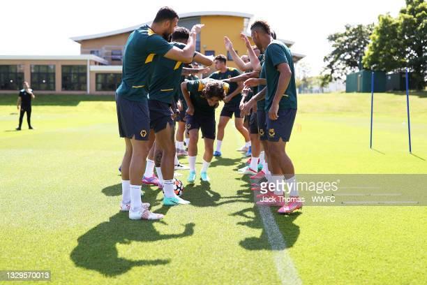 Fabio Silva of Wolverhampton Wanderers runs through his teammates as they celebrate his birthday during a Wolverhampton Wanderers Pre-Season Training...