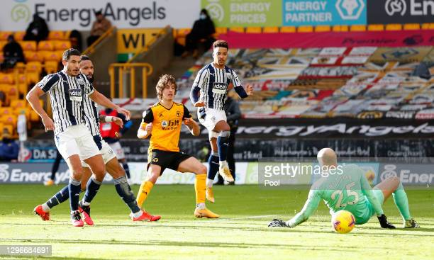 Fabio Silva of Wolverhampton Wanderers scores his team's first goal past David Button of West Bromwich Albion during the Premier League match between...