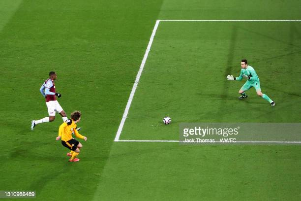 Fabio Silva of Wolverhampton Wanderers scores his teams second goal past Lukasz Fabianski of West Ham United during the Premier League match between...