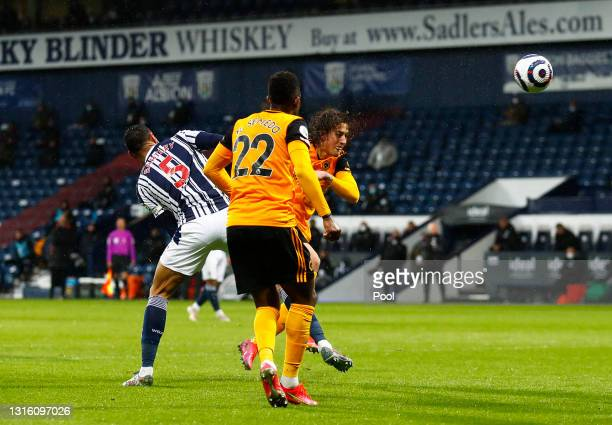 Fabio Silva of Wolverhampton Wanderers scores their side's first goal whilst under pressure from Kyle Bartley of West Bromwich Albion during the...