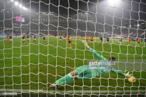 Fabio Silva of Wolverhampton Wanderers scores their team's first goal from the penalty spot past Nick Pope of Burnley during the Premier League match...