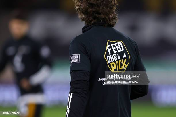 Fabio Silva of Wolverhampton Wanderers wears a Feed our pack t-shirt during the warm up prior to the Premier League match between Wolverhampton...
