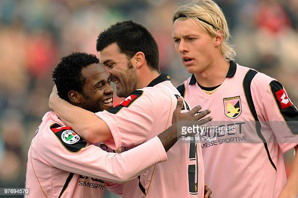 Fabio Simplicio of Palermo celebrates the equalizing goal with team-mates Cesare Bovo and Simon Kjaer during the Serie A match between Udinese Calcio...